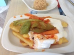 Chips with fried carrots and pepper topped with yoghurt, a calorie bomb but delicious