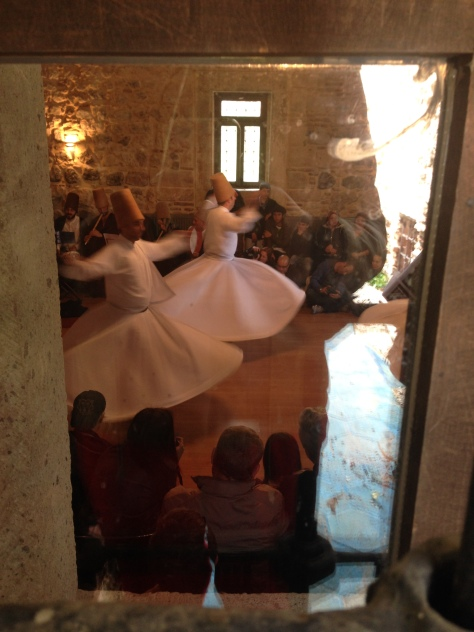 Through the looking glasses, the Whirling Dervishes